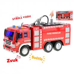 Auto hasiči 27cm 1:16 stříkající vodu na setrvačník na baterie se světlem a zvukem v krabičce