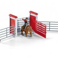 Kovboj na býku v ohradě